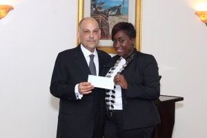 Antigua and Barbuda Minister of Tourism, the Hon. Asot Michael makes presentation to 2015 JCI President Shenella Govia.